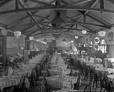 Old Heidelberg Inn restaurant at the Century of Progress, 1933. , Interior, dining room filled with tables and chairs with plaid table cloths lined in...