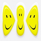 three smiley symbols talking to eachother in intimity