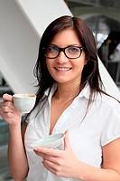 The businesswoman drinks coffee
