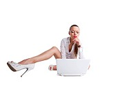 sexy confused woman sit with laptop and long legs