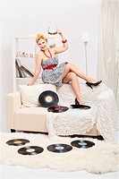 blonde woman with vinyls