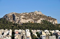 View of Lykavittos hill from Strefi hill during sunset, Athens, Greece
