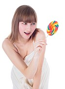 Bright picture of hungry blonde with color lollipop
