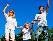 Lively family jumping in the air
