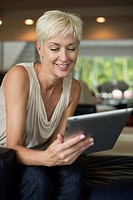 Caucasian woman using digital tablet