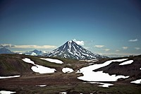 Patches of snow in a valley in front of Koryaksky Volcano, Russia