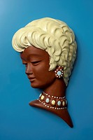 A retro wall hanging of a woman with short blond hair