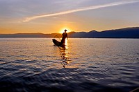 Silhouette of a person on a boat, Inle Lake, Burma