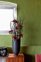 A vase of flowers on a sideboard