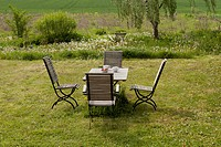 An outdoor table and chairs set for breakfast