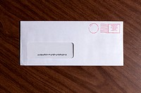 A window envelope with no address, but a barcode and red ink postage stamp (thumbnail)