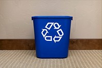 A blue recycling bin