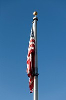 An American flag hanging down