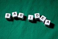 Lettered cubes spelling the words BAD IDEA