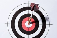 A dart in the bull's eye of a target