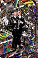 Two male figurines lying on confetti and streamers
