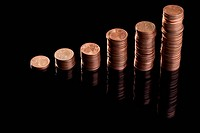 Rows of stacks of five cent Euro coins increasing in size (thumbnail)