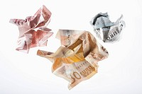 Crumpled Euro banknotes on a white background