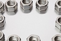 Metal nuts arranged in a circle
