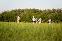 Children running in a field