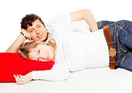 Happy couple laying on red pillow over white