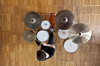 Drummer plays kit