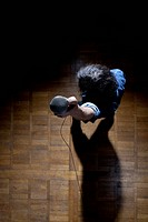 High angle view of man holding mic up to camera