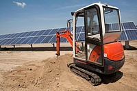 Mechanical digger on solar panel construction site (thumbnail)
