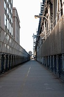 Jogger on pedestrian walkway on Manhattan Bridge