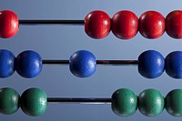 The red, blue and green beads of an abacus, close-up (thumbnail)
