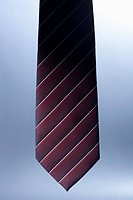 The bottom of a striped, silk necktie