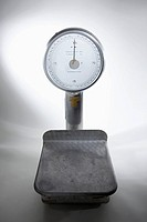 An old-fashioned, empty kitchen scale (thumbnail)
