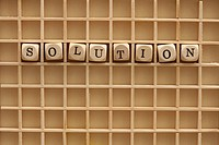 A grid with lettered cubes spelling the word Solution
