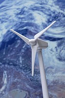 A model of a wind turbine, planet earth in the background