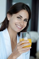 Woman with glass of fresh orange juice