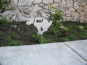 No toilet for dogs symbol on public lawn by sidewalk (thumbnail)
