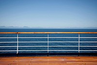 Sun shining on the boat deck of a passenger ship, Canadian coastline in background (thumbnail)