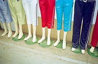 Display of mannequins wearing tracksuit shorts