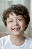 A young cheerful boy, head and shoulders