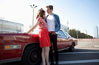 A flirtatious rockabilly couple standing next to a vintage car, Berlin, Germany (thumbnail)