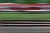 Railroad tracks and a train, blurred motion, viewed from a moving train