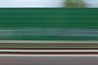 A building and abstract pattern in blurred motion viewed from moving train (thumbnail)