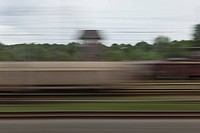 A village in blurred motion viewed from a moving train (thumbnail)