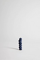 Blueberries arranged into a stack, studio shot