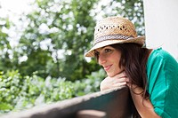 Smiling woman leaning on banister