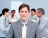 Close_up of a smiling young businessman in a meeting