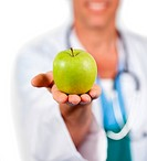 Close_up of a doctor presenting a green apple