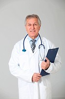 Senior doctor standing on white background