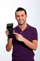 Young man on white background holding calculator
