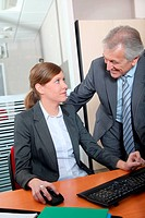 Senior businessman with young woman in the office